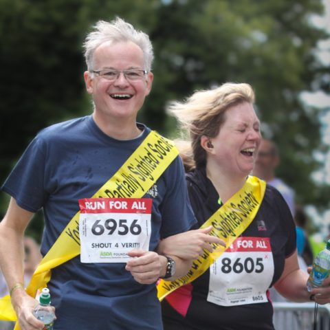 member and volunteer taking part in York 10k run