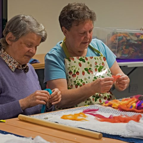 A volunteer helping with a craft activity
