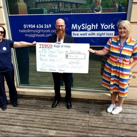 Scott Jobson and Lizzy Powell receiving a cheque from Tesco Askham Bar